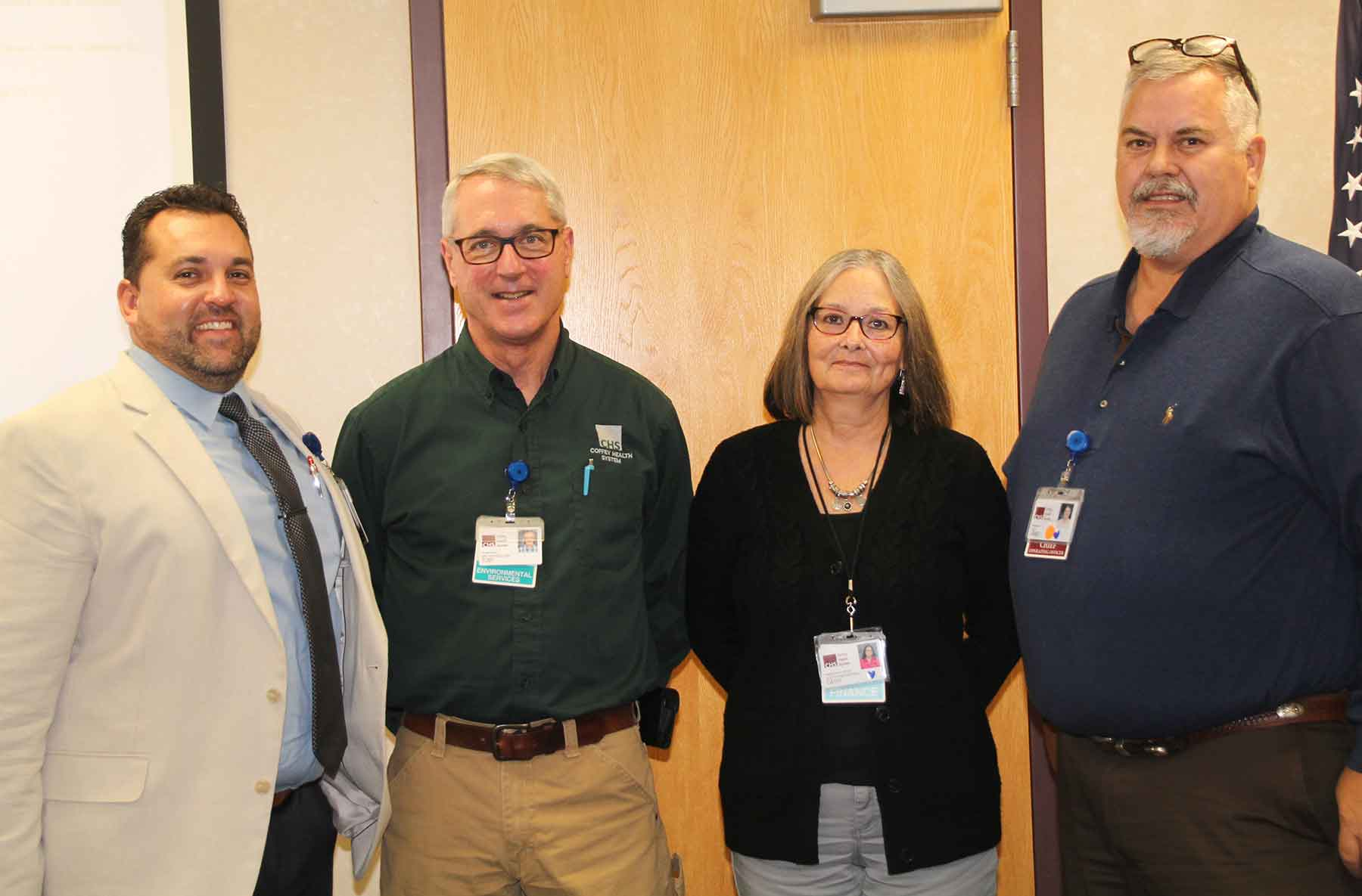 Jeremy Clingenpeel, Kansas Health Care Worker of the Year Toby Paige, Cathy Paige, James Higgins